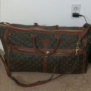 Louis Vuitton luggage duffle bag